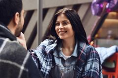 Girl in denim jacket covered in plaid. Stock Photos