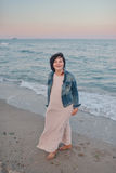 Girl in the denim jacket by the sea Royalty Free Stock Photo