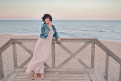 Girl in the denim jacket by the sea Royalty Free Stock Photos