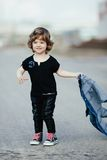 Girl with denim jacket on the street Royalty Free Stock Photography