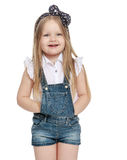 Girl in denim overalls Stock Images