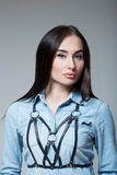 Girl in a denim shirt with straps Stock Photography