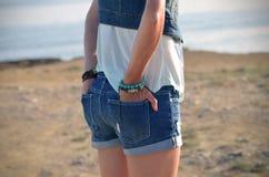 Girl in denim short shorts Royalty Free Stock Photo