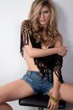 Girl in denim shorts Stock Images