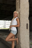 Girl in denim shorts and white T-shirt Stock Images