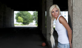 Girl in denim shorts and white T-shirt Stock Image