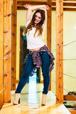 Girl in denim trousers high heels boots Royalty Free Stock Photography