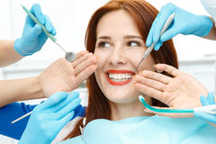 Girl in dentist chair showing the perfect smile. Attractive girl in the dentist chair showing the perfect smile Royalty Free Stock Photos