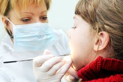 Girl at a dentist examination Stock Image