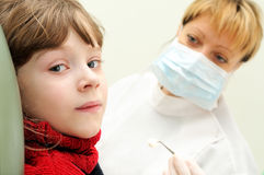 Girl at a dentist examination Royalty Free Stock Image