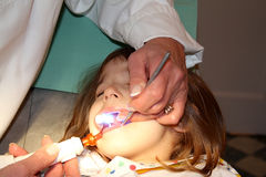 Girl in the dentist office Royalty Free Stock Photos