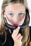Girl deploying sunglasses. Portrait of a girl deploying sunglasses royalty free stock photography