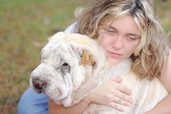 Girl depressed white dog. Young woman depressed with best friend white dog
