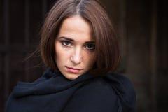 Girl in depression on dark background stock image