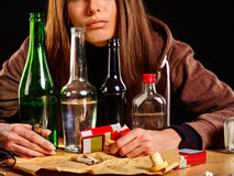 Girl in depression drinking alcohol. Drinking habits. Royalty Free Stock Photo