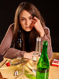 Girl in depression drinking alcohol. Royalty Free Stock Photos