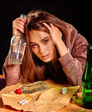 Girl in depression drinking alcohol. Stock Photos