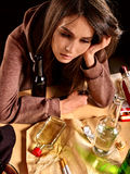 Girl in depression drinking alcohol Royalty Free Stock Image