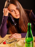 Girl in depression drinking alcohol. Stock Image