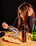 Girl in depression drinking alcohol. Stock Photography