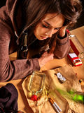 Girl in depression drinking alcohol Stock Images