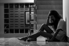 Girl in depression drinking alcohol in solitude Royalty Free Stock Photo