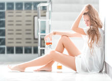 Girl in depression drinking alcohol in solitude Royalty Free Stock Image
