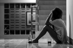 Girl in depression drinking alcohol in solitude Royalty Free Stock Photography