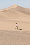 Girl in the desert. A young girl taking a walk in the arid desert Royalty Free Stock Photos