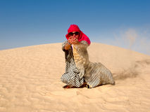 Girl in the desert Stock Images