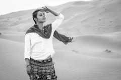 Girl in a desert. A girl hikes on the dunes of Sahara desert Royalty Free Stock Photos