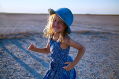 Girl in the desert Royalty Free Stock Image