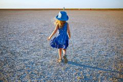 Girl in the desert Royalty Free Stock Photo