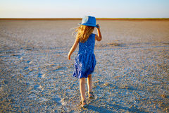 Girl in the desert Stock Image