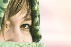 Girl in the desert with a veil. Detail of a woman`s eye royalty free stock photography
