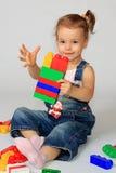 Girl and designer. A little girl plays a designer Stock Image