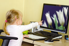 Girl at desktop computer Stock Photo
