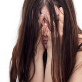 Girl in despair. Shuts the face with the hands Royalty Free Stock Photos