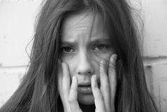 A Girl In Despair. Portrait of a young girl in despair Royalty Free Stock Photos