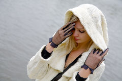 The girl in despair and grief. Against the river Royalty Free Stock Photo