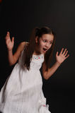 Girl in despair. Girl in a white dress on a black background in despair Stock Images