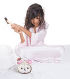 Girl Destroy Alarm Clock VI. Irritated young Asian Malay girl waking up from sleep and destroying alarm clock stock images