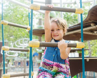 Girl developing dexterity at playground Royalty Free Stock Photo