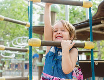 Girl developing dexterity at playground Royalty Free Stock Photos