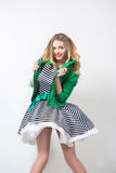 Girl in the developing dress and green jacket. Stock Photos