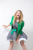 Girl in the developing dress and green jacket. Royalty Free Stock Image