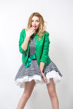 Girl in the developing dress and green jacket. Stock Images