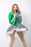 Girl in the developing dress and green jacket. Stock Photo
