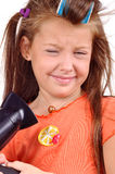 Girl with developing hair and hairdryer Stock Photo
