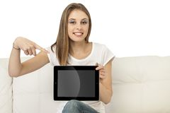 Girl with device. Beautiful girl with device on a white background Stock Images